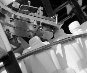 دستگاه پرکن و در بند روتاری مواد اسیدی توان صنعت                                                                                                                                                   300x250