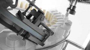 دستگاه پرکن و در بند روتاری مواد اسیدی توان صنعت                                                                                                                                                                                           300x167