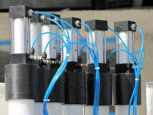 دستگاه پرکن و در بند روتاری مواد اسیدی توان صنعت                                                                                                                                                              300x225